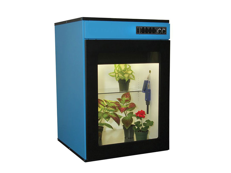 blue metal environmental chamber with plants inside