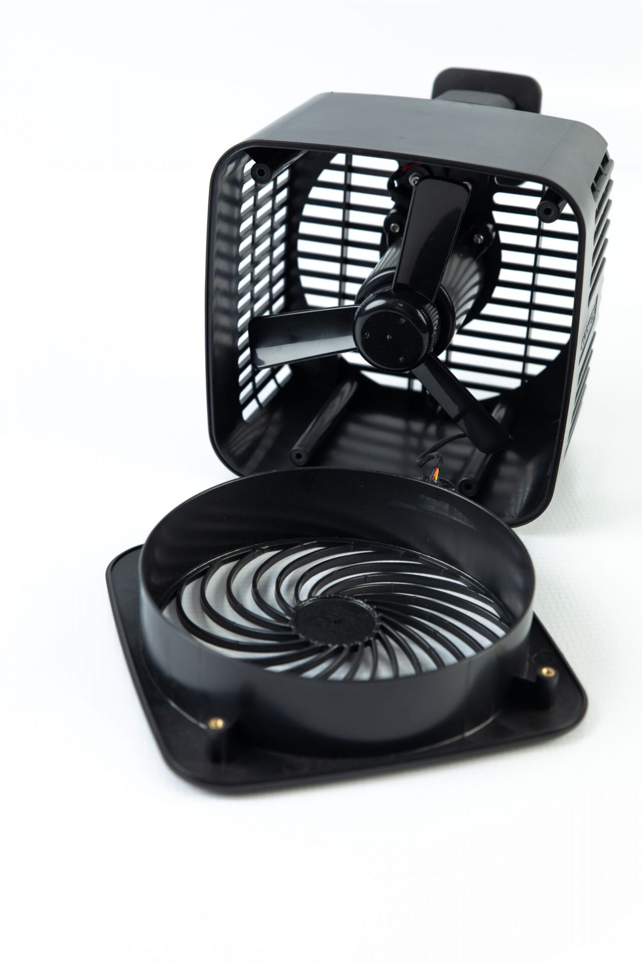 black plastic electric fan opened to view the inside
