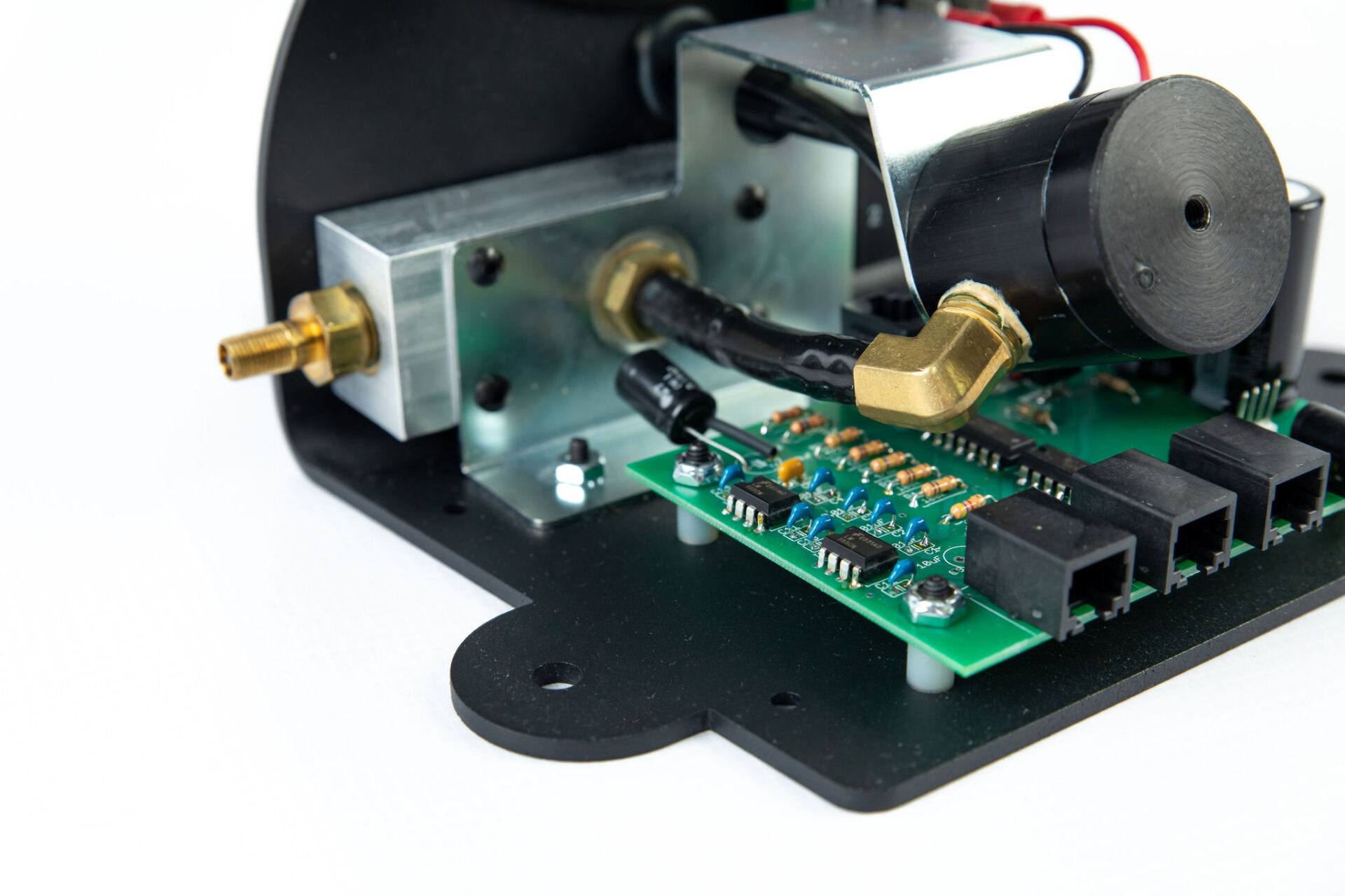 close up of electromechanical part with pcb board