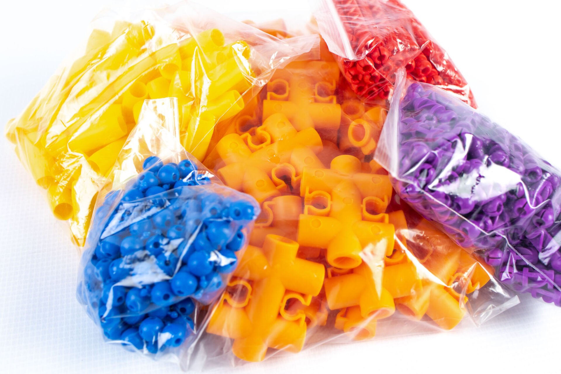close up of colorful plastic pieces in clear plastic bags