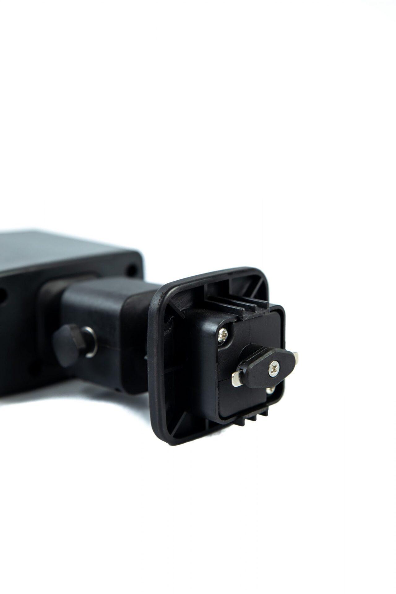 black plastic mounting device